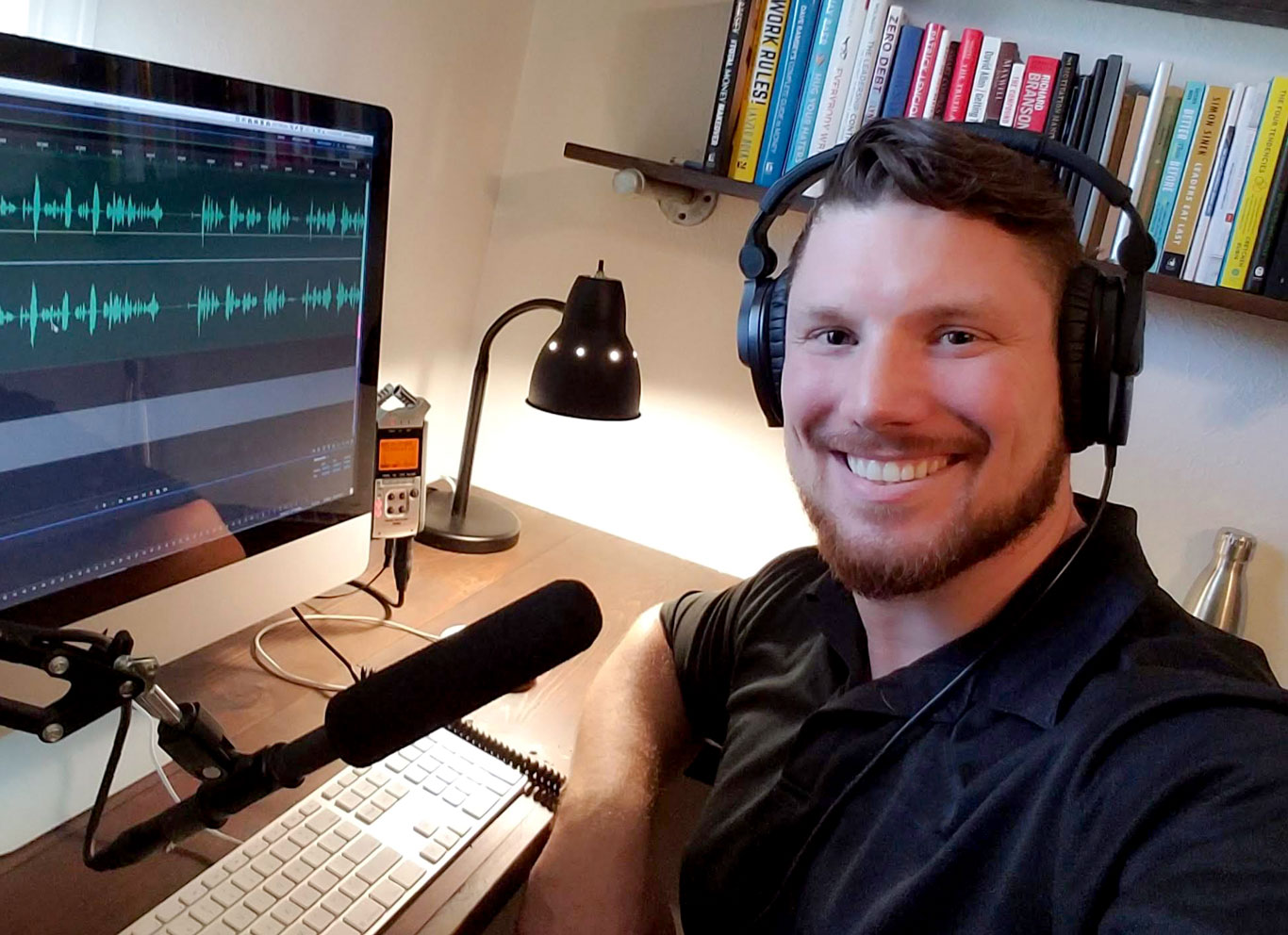 photo of Austin Bollinger recording an episode of the Daily New Years Podcast